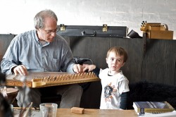 Jeff Greene playing an instrument from the Qanun from Turkey.